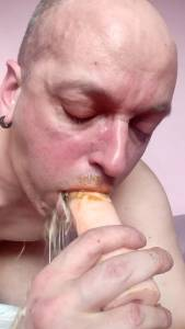 faggot puking on scat covered dildo