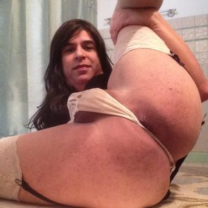 Faggot queer proudly displays her big ass and anus in hopes of attracting a hung dom master.