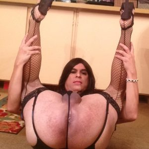 Tranny fuck pig on her back.legs up in the air exposing her cum tunnel to men.FIll this cumdump slut with seed and claim her as your whore.